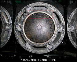 Click image for larger version.  Name:Center jug with close up of piston dings.jpg Views:81 Size:177.2 KB ID:238415