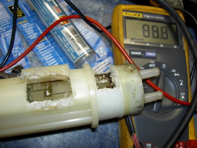 fuel baffle sending unit repair first pic here i used a weller ering iron to cut open a hole to get an internal view of the circuit board and the location of the f1 fuse near the top